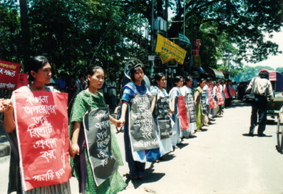 June 12, 2003 HWF forms human chain at Dhaka press club Dhaka press club demanding of the govt to make Kalpana Chakma abuduction report public