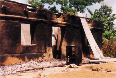 JSS burns the house of an UPDF supporter at Shib Mondir, Khagrachari 13 Sept 2001